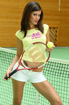 Little Caprice Using The Racquet As A Toy On The Tennis Court - Picture 1